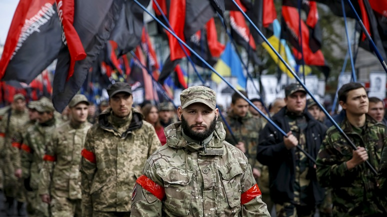 Members of Right Sector take part in a rally held by far-right radical groups to mark the Day of Defender of Ukraine in Kiev